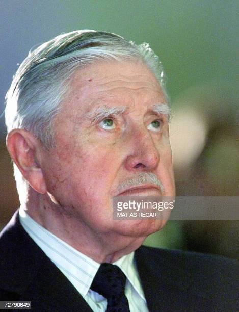 Picture taken 30 August 2000 of former Chilean dictator Augusto Pinochet during mass at a Navy chapel in Vina del Mar, 100 Km west of Santiago....