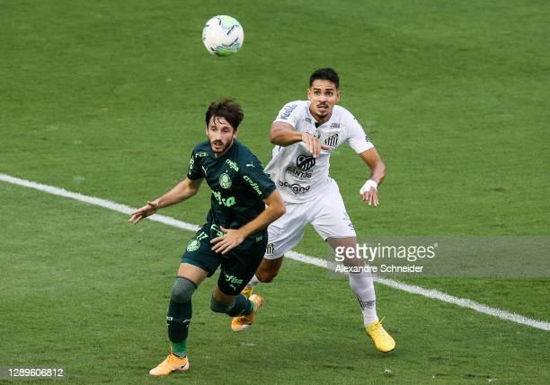 Vina of Palmeiras and Lucas Verissimo of Santos fight for the ball during the match as part of Brasileirao Series A 2020 at Vila Belmiro Stadium on...