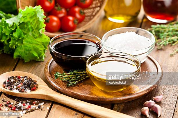 Vinaigrette ingredients on rustic wood table