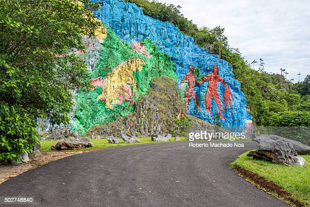 Vinales Valley in Pinar del RioCuba is a Unesco World Heritage site since 1999 The Prehistory mural painted in the wall of a cliff is one of the...