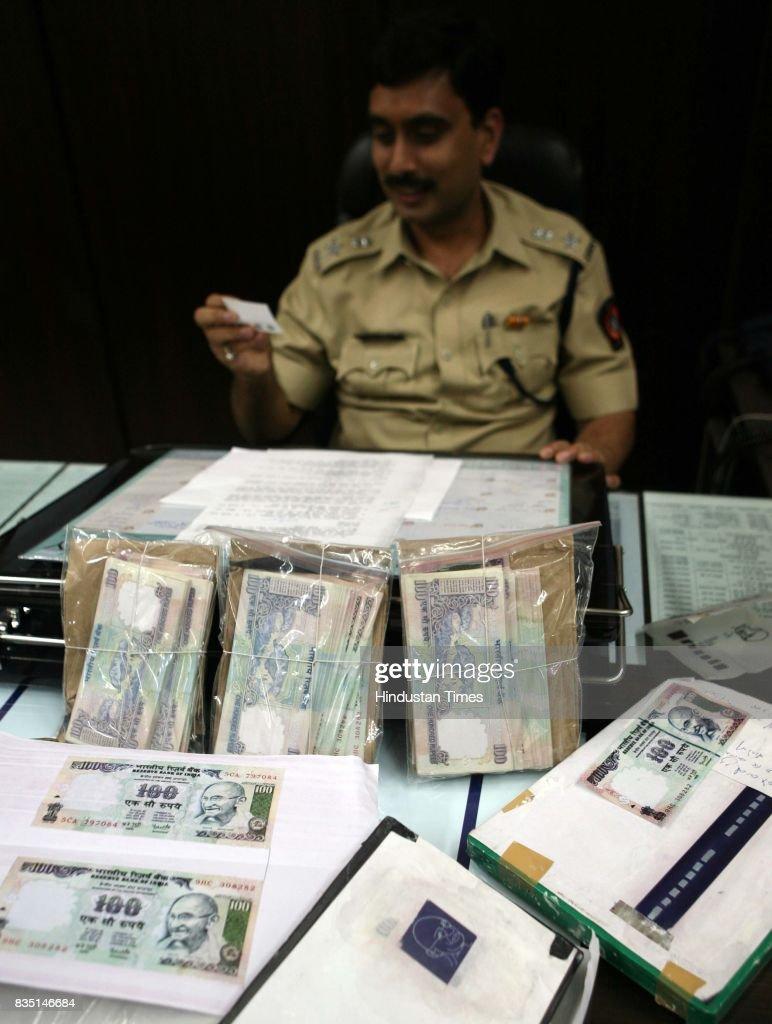 Vinay Kumar Choubey DCP Zone IX X Counterfeit Fake Notes Oshivara Police display the seized fake notes.