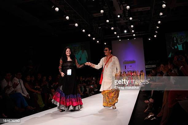 Vinay Pathak Agnimitra Paul on the runway during day four of Lakme Fashion Week Summer/Resort 2013 on March 25 2013 at Grand Hyatt in Mumbai India