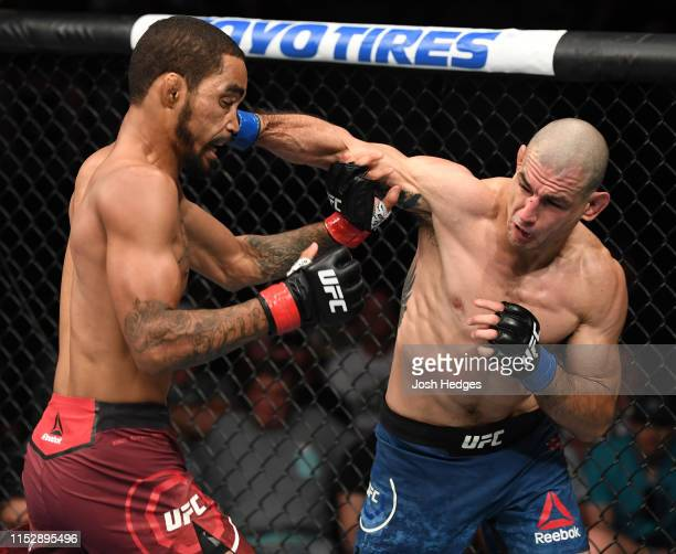 Vinc Pichel punches Roosevelt Roberts in their lightweight bout during the UFC Fight Night event at the Target Center on June 29 2019 in Minneapolis...
