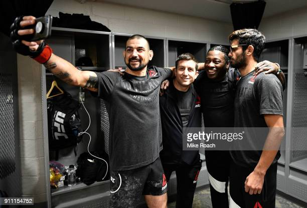 Vinc Pichel takes a picture with his team backstage during a UFC Fight Night event at Spectrum Center on January 27 2018 in Charlotte North Carolina