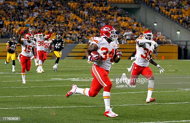 Vince Agnew of the Kansas City Chiefs runs back a kickoff for a touchdown one hundred nine yards against the Pittsburgh Steelers in the second half...