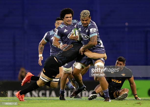 Vince Aso of Hurricanes is tackled by Joaquin Diaz Bonilla of Jaguares during a match between Jaguares and Hurricanes as part of Super Rugby 2020 at...