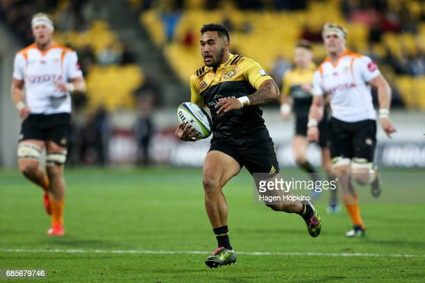 Vince Aso of the Hurricanes breaks away to score a try during the round 13 Super Rugby match between the Hurricanes and the Cheetahs at Westpac...