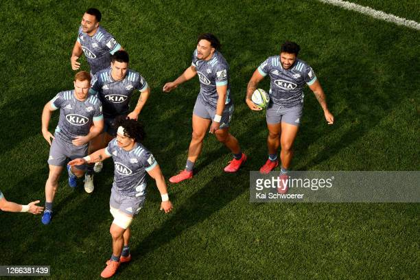 Vince Aso of the Hurricanes celebrates with the team after scoring a try during the round 10 Super Rugby Aotearoa match between the Highlanders and...