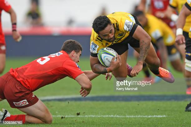 Vince Aso of the Hurricanes is tripped during the round five Super Rugby match between the Hurricanes and the Sunwolves at McLean Park on February...