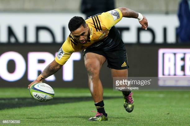 Vince Aso of the Hurricanes scores a try during the round 13 Super Rugby match between the Hurricanes and the Cheetahs at Westpac Stadium on May 20...