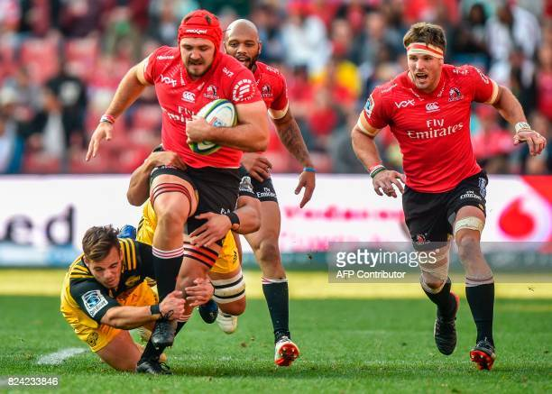 Vince Aso of the Hurricanes tackles Cyle Brink of the Lions during the Super Rugby semifinal match between Lions and Hurricanes at Ellis Park Rugby...