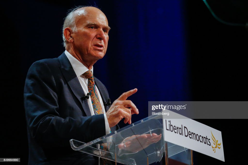 Vince Cable, leader of the U.K.'s Liberal Democrat Party, gestures as he delivers his keynote speech at the party's annual conference in Bournemouth, U.K., on Tuesday, Sept. 19, 2017. Cable said U.K. Prime Minister Theresa May should fire her foreign secretary, Boris Johnson, over an article he published on Saturday about Britains departure from the European Union. Photographer: Luke MacGregor/Bloomberg via Getty Images