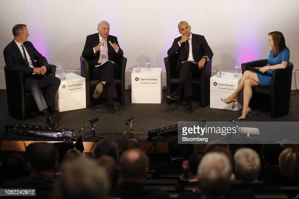 Vince Cable UK business secretary second left speaks as left to right Nick Boles UK minister of state for skills and equalities Chuka Umunna business...