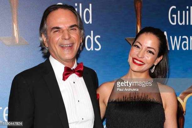 Vince Calandra and Emmanuelle Vaugier attend the 2019 Writers Guild Awards LA ceremony at The Beverly Hilton Hotel on February 17 2019 in Beverly...