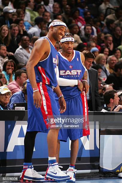 Vince Carter and Allen Iverson of the Eastern Conference AllStars look on against the Western Conference in the 54th AllStar Game part of 2005 NBA...
