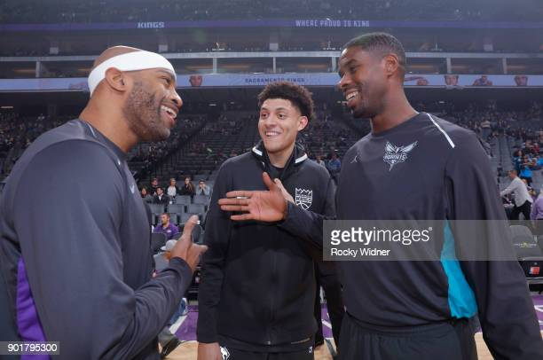 Vince Carter and Justin Jackson of the Sacramento Kings shake hands with Marvin Williams of the Charlotte Hornets before the game on January 2 2018...