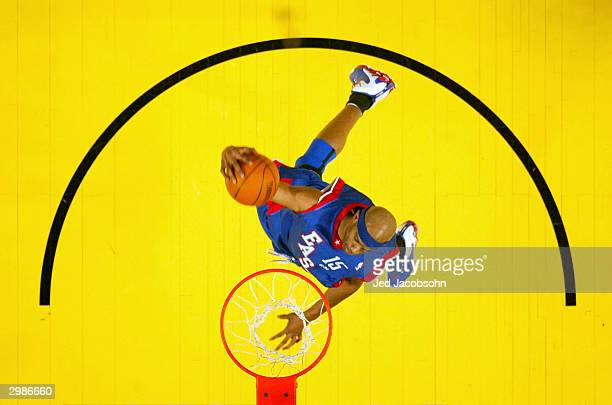 Vince Carter from the Toronto Raptors of the Eastern Conference All-Stars goes to the basket for a dunk against the Western Conference All-Stars...