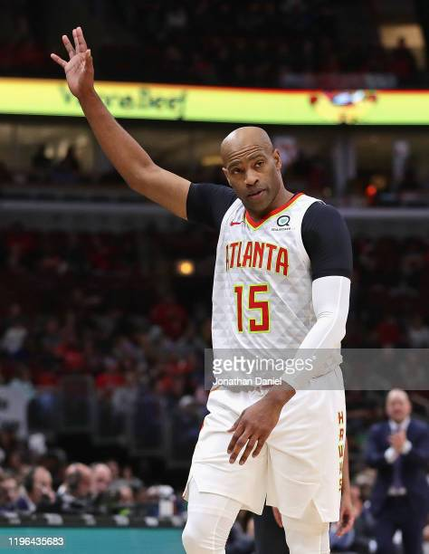 Vince Carter of the Atlanta Hawks acknowledges the crowd as he leaves his last game at the United Center against the Chicago Bulls at the United...
