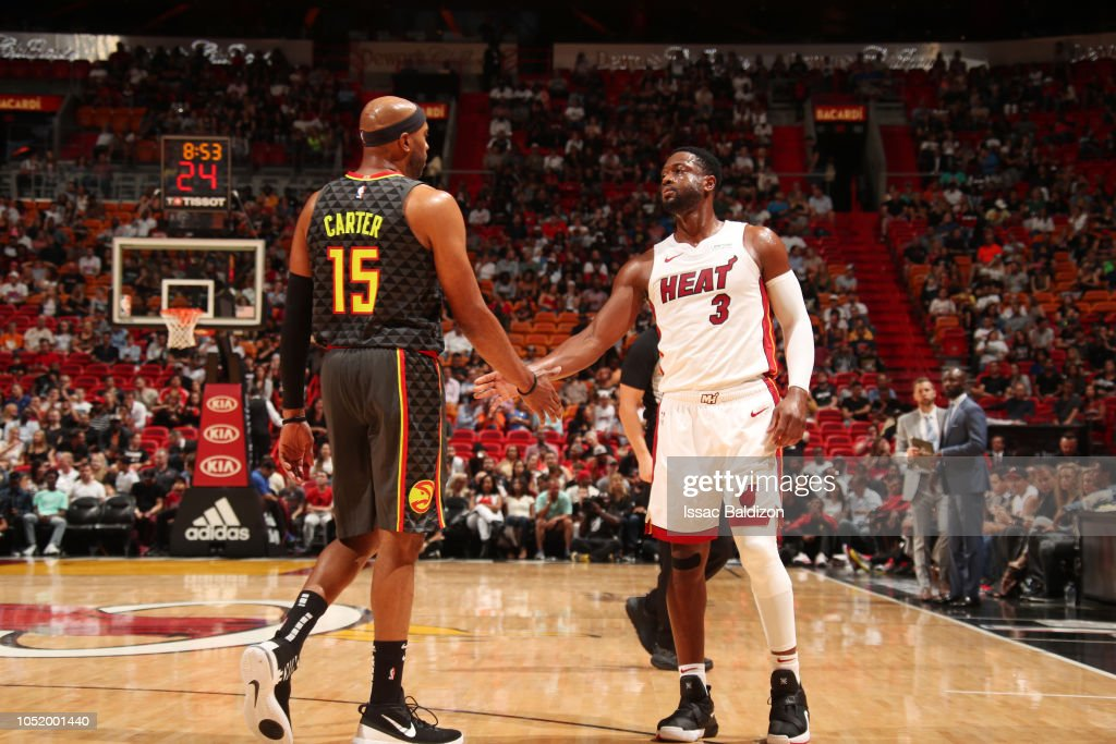 44cd40db79b Vince Carter of the Atlanta Hawks and Dwyane Wade of the Miami Heat ...