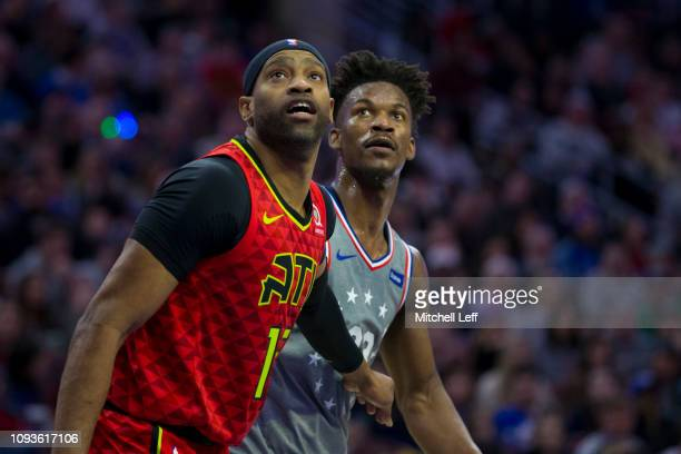 Vince Carter of the Atlanta Hawks boxes out Jimmy Butler of the Philadelphia 76ers at the Wells Fargo Center on January 11 2019 in Philadelphia...