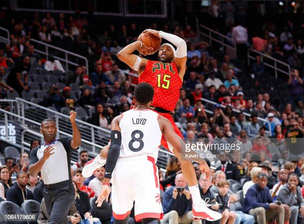 Vince Carter of the Atlanta Hawks draws a foul from Jordan Loyd of the Toronto Raptors at State Farm Arena on November 21 2018 in Atlanta Georgia...