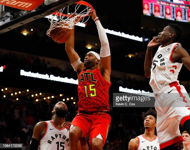 Vince Carter of the Atlanta Hawks dunks and scores his 25000th NBA point in the final seconds of their 124108 loss to the Toronto Raptors at State...