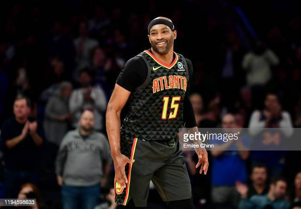 Vince Carter of the Atlanta Hawks gives a goodbye to the crowd as he exits the court during their game against the New York Knicks at Madison Square...