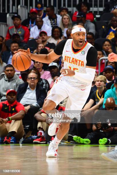 Vince Carter of the Atlanta Hawks handles the ball during the game against the Golden State Warriors on December 3 2018 at State Farm Arena in...