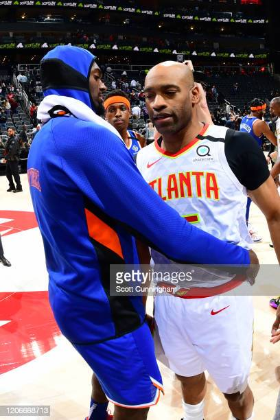 Vince Carter of the Atlanta Hawks hugs a New York Knicks player after the game on March 11, 2020 at State Farm Arena in Atlanta, Georgia. NOTE TO...
