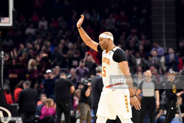 Vince Carter of the Atlanta Hawks reacts after being honored by the Cleveland Cavaliers during the first half at Rocket Mortgage Fieldhouse on...
