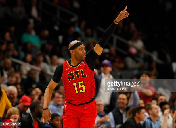 Vince Carter of the Atlanta Hawks reacts after hitting a threepoint basket against the Memphis Grizzlies in the first half at State Farm Arena on...