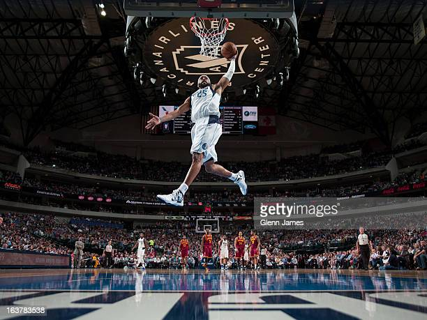Vince Carter of the Dallas Mavericks dunks on a fast break against the Cleveland Cavaliers on March 15, 2013 at the American Airlines Center in...