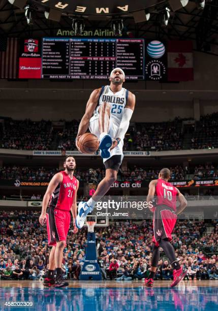 Vince Carter of the Dallas Mavericks goes in for the dunk against the Toronto Raptors on December 20, 2013 at the American Airlines Center in Dallas,...