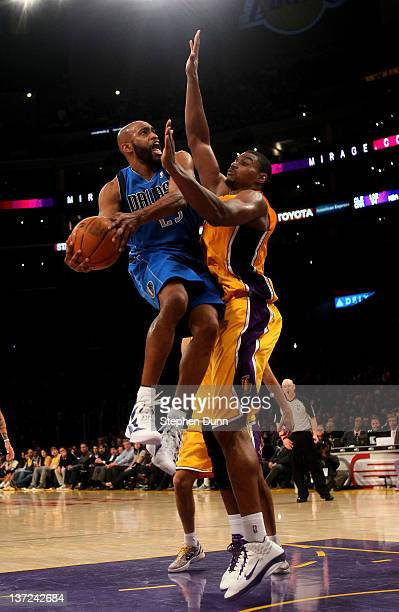 Vince Carter of the Dallas Mavericks goes up and scores over Andrew Bynum of the Los Angeles Lakers at Staples Center on January 16 2012 in Los...