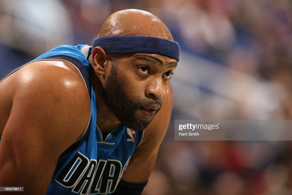 Vince Carter #25 of the Dallas Mavericks looks on during the game against Charlotte Bobcats at the Greensboro Coliseum on October 19, 2013 in Greensboro, North Carolina.