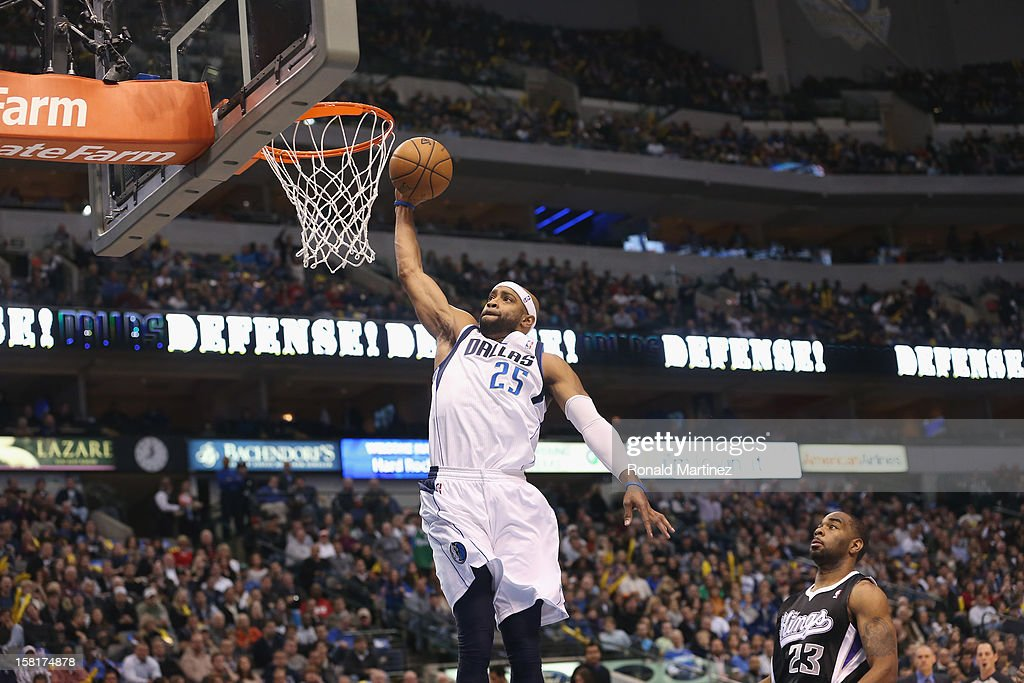 Vince Carter #25 of the Dallas Mavericks makes the slam dunk against Marcus Thornton #23 of the Sacramento Kings at American Airlines Center on December 10, 2012 in Dallas, Texas.