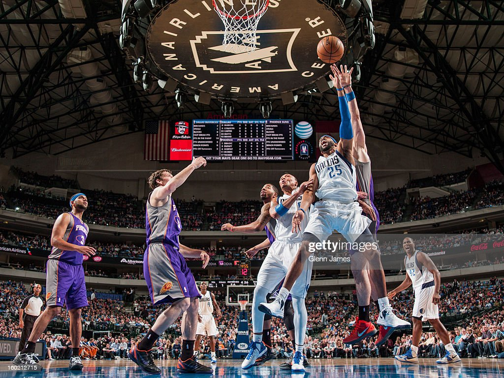 Vince Carter #25 of the Dallas Mavericks shoots a layup against the Phoenix Suns on January 27, 2013 at the American Airlines Center in Dallas, Texas.
