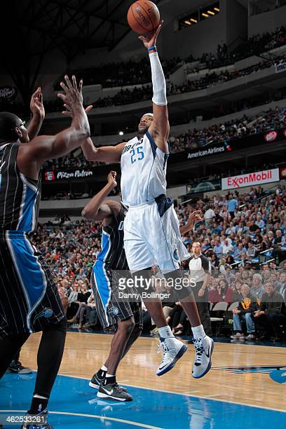 Vince Carter of the Dallas Mavericks shoots against Jason Maxiell of the Orlando Magic on January 13 2014 at the American Airlines Center in Dallas...