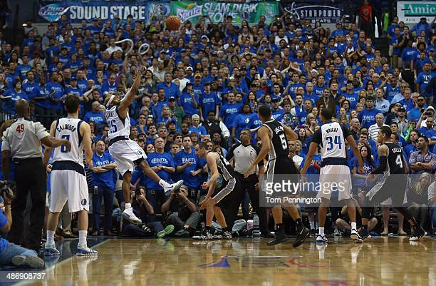 Vince Carter of the Dallas Mavericks shoots the game winning shot as the Mavericks beat the San Antonio Spurs 109-108 during Game Three of the...