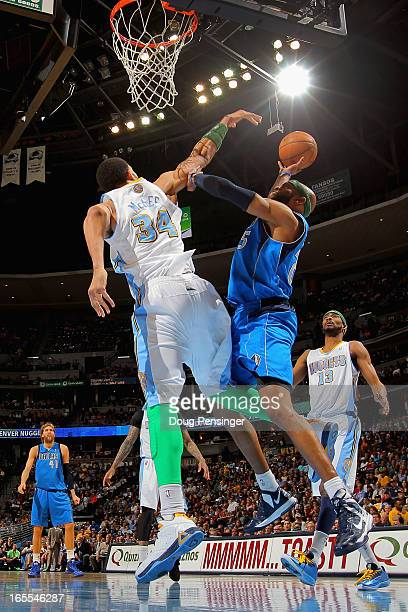 Vince Carter of the Dallas Mavericks tries to get off a shot against JaVale McGee of the Denver Nuggets at the Pepsi Center on April 4 2013 in Denver...