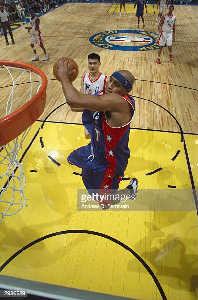 Vince Carter of the East drives to the basket for a dunk during the 2004 NBA AllStar Game at the Staples Center part of the 53rd NBA AllStar Weekend...