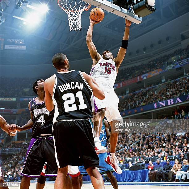Vince Carter of the Eastern Conference All-Stars attempts a layup against Chris Webber and Tim Duncan of the Western Conference All-Stars during the...
