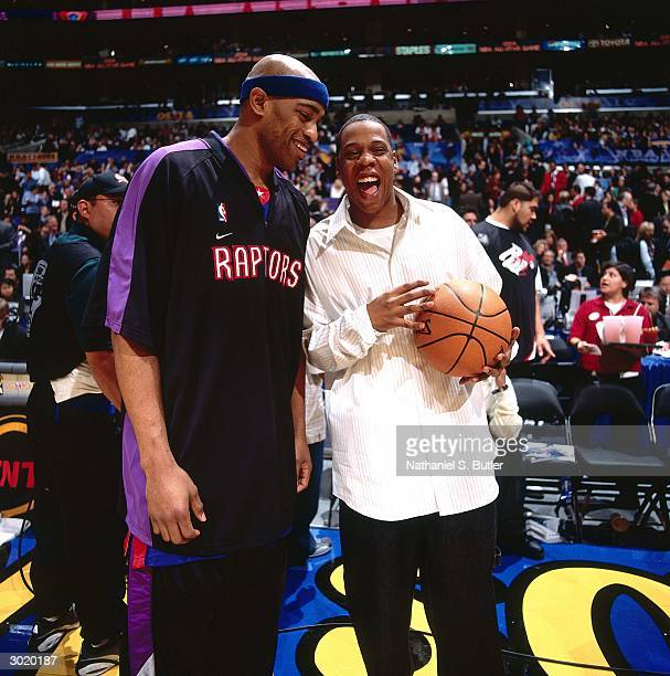 Vince Carter of the Eastern Conference AllStars jokes around with JayZ prior to the 2004 AllStar Game on February 15 2004 at Staples Center in Los...