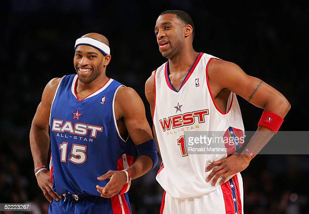 Vince Carter of the Eastern Conference All-Stars laughs with Tracy McGrady of the Western Conference All-Stars during the 54th All-Star Game, part of...