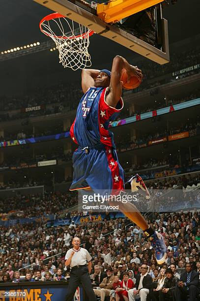 Vince Carter of the Eastern Conference drives to the basket for a dunk against the Western Conference during the 2004 NBA All-Star Game at the...