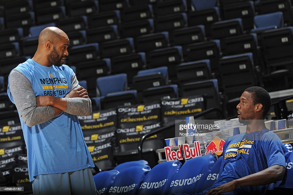 Vince Carter #15 of the Memphis Grizzlies and Harrison Barnes #40 of the Golden State Warriors speak before a game on April 13, 2015 at Oracle Arena in Oakland, California.