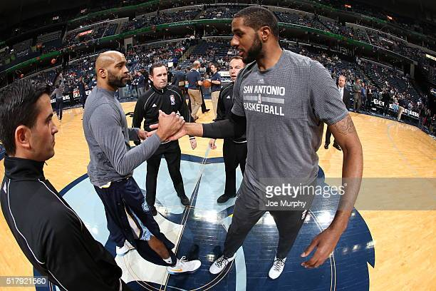 Vince Carter of the Memphis Grizzlies and LaMarcus Aldridge of the San Antonio Spurs shake hands before the game on March 28 2016 at FedExForum in...