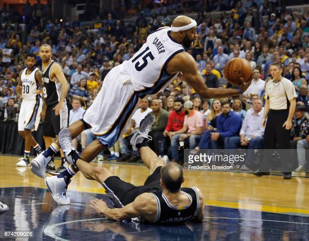 Vince Carter of the Memphis Grizzlies collides with Manu Ginobili of the San Antonio Spurs during the first half of Game 6 of the Western Conference...