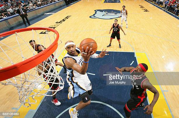 Vince Carter of the Memphis Grizzlies drives to the basket and shoots the ball against the Toronto Raptors on January 25 2017 at FedExForum in...