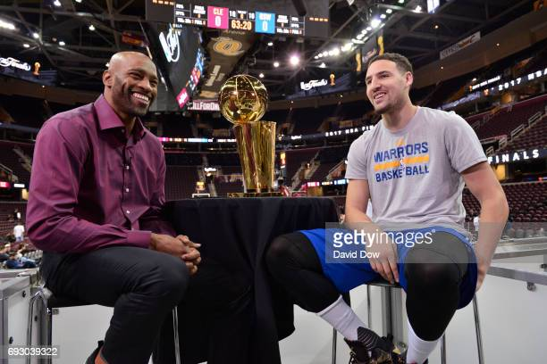 Vince Carter of the Memphis Grizzlies moderates a Facebook Live chat with Klay Thompson of the Golden State Warriors during media availability as...
